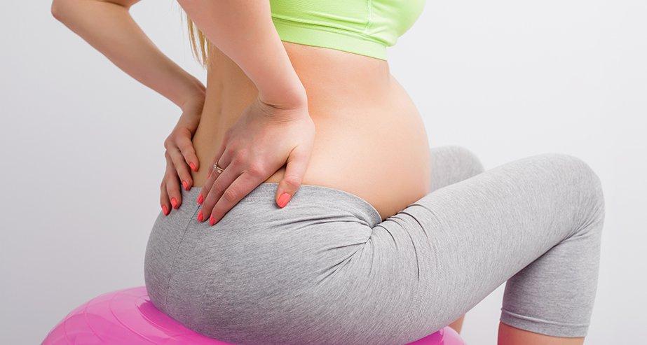 13 причин боли в копчике при беременности, нормально ли это?